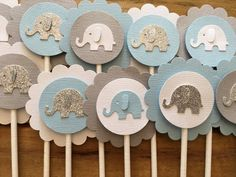 Brighten up your occasion with these adorable Elephant Cupcake Toppers made from high quality cardstock. Perfect for a baby shower or boys birthday party. QUANTITY • 12-Elephant Cupcake Toppers COLORS • Blue, Gray, Silver & White SIZE • Scalloped outer circle measures