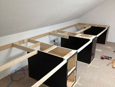 Turning sloped ceiling low-spots into desk area.