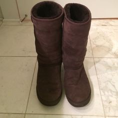 Ugg classic tall boot chocolate - size 8 Worn only a couple times. Shearling is in perfect condition. Soles show no wear. Great deal for this winter! UGG Shoes Winter & Rain Boots