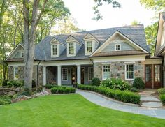 Home exterior. The exterior stone is Tennessee Grey Orchard. Exterior trim paint color is Benjamin Moore White Dove. Wood Door stain is Provential with 20% brown tint added.