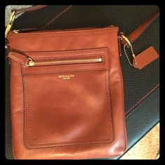"""Coach crossbody purse Authentic Coach crossbody. Purchased from Dillards. Leather, camel brown color with gold zippers and hardware. Strap has gold belt fastener to change length. Strap is 46"""" long. Has a couple minor nicks from wear 2 on front and 1 on back but can see from the picture they are as small as a pin needle. Comes with white silk coach bag. Coach Bags Crossbody Bags"""