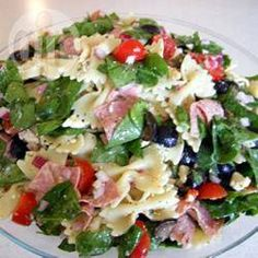 Feta Pasta Salad with Spinach  A warm pasta salad with spinach, feta and and black olives. Wilt the spinach by pouring the pasta water over it. I usually serve this warm but it makes a good cold salad as well.