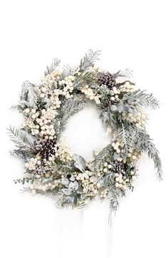 Christmas Decorations and Décor – flocked wreath with white berries.