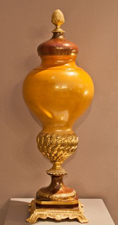 Big centerpiece, painted background color and gold, bronze base.
