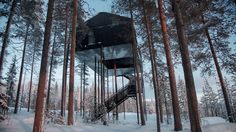 Snøhetta has completed a treetop cabin for the Treehotel in Sweden, featuring charred-timber cladding and a suspended net for observing the Northern Lights