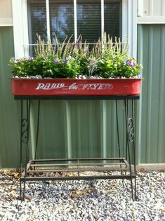 Old fish tank base with little red wagon filled with sun loving plants. Reuse, r. Old fish tank ba Outdoor Projects, Garden Projects, Outdoor Decor, Garden Ideas, Radio Flyer Wagons, Little Red Wagon, Sun Loving Plants, Pot Plante, Miniature Fairy Gardens