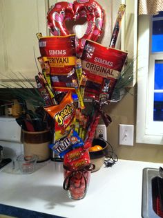 Bouquet for men. Jerky, pistachios, Cheetos, Reese's, use his favorite snacks. I used dal rods to hold up the food. Great gift for guys :)
