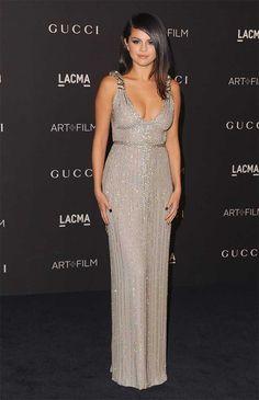Selena Gomez wears a Gucci custom-made pale grey silk dress to the LACMA Art + Film Gala, November 2014.