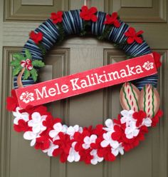 Love love love this! The song and the scene from Christmas Vacation come immediately to mind!!!! Mele Kalikimaka wreath by Ohanalee on Etsy, $50.00