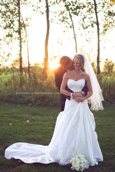 Beautiful bride posing with her groom