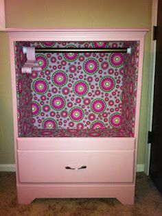 Dress up closet using old dresser. Take out drawers and bars, wallpaper, add tension bar, add princess dresses on bar, shoes and tiaras in drawers below.