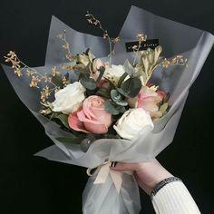 Resultado de imagem para bouquet wrapped in plastic