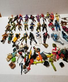 Lot Of 28 G.I. Joe figures Weapons Missiles and Body Parts 1980s