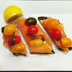 Smoked #salmon tartine, lemon, salt, pepper, herbs with #tomatoes on #multigrain toast