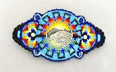 Hasha Cole (Northern Arapaho), silver and beaded eagle's head barrette