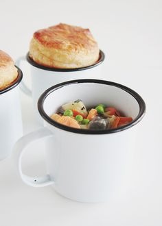 "Veggie Pot Pies in a Mug: ""Crisp temperatures. Cozy couches. Comfort food. Lazy weekends. Sideways sun. Mug filled hands. Red tipped noses. Chunky knit socks. Blue faded jeans. Apple cider donuts. Wood crackling bonfires. She's back in full force. Hi, Autumn."""
