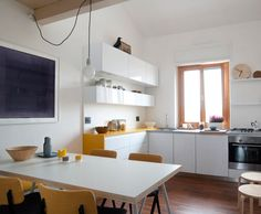 A pretty basic kitchen with a POP of yellow.  - Roomed | roomed.nl
