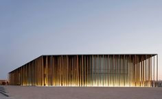 The Zaragoza Expo Pavilion is lit with simple lighting come from the bottom of the structure.