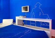 """""""Designed by Barr Gilmore & Michel Arcand, the room is painted Chroma-Key blue 'allowing visitors to make their own digital videos in the room and edit them later using whatever backgrounds they desire.' """"    If this isn't an invitation to make porn, I don't know what is."""