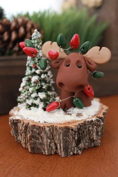 This OOAK (one of a kind) sculpture has been entirely hand sculpted from polymer clay by me and features an adorable little moose who has suddenly