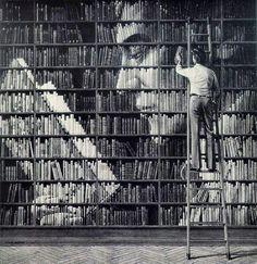 A man put books in a shelf with great accuracy .. books library art وضع رجل الكتب في مكتبة وجعلها تتشكل بشكل قارئ يقرأ كتابا .. وهي لوحة فنية بالغة العمق والجمال ..