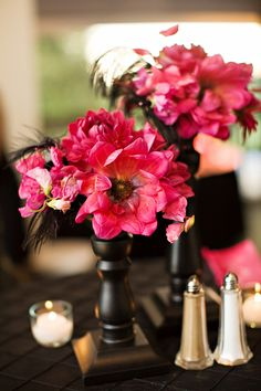 hot pink wedding centerpiece with black vase