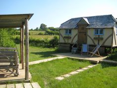 Glamping at Swallowtail Hill, East Sussex. This cottage is a one off - hand built by highly skilled local craftsmen with timber sourced from local woods, it's a quirky cottage on wheels.http://www.organicholidays.com/at/3197.htm