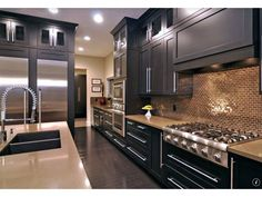 Here's a dark galley kitchen that's relatively narrow and long