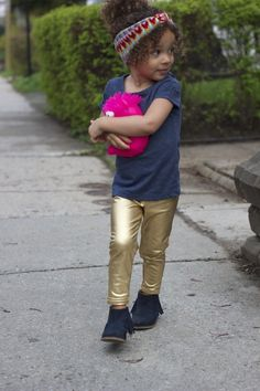 She picked out a headband and a pair of metallic gold pants #Headband #GoldPants #KidsFashion
