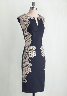 $100. You're ringing in the New Year at your upstate lodge, and you look as gorgeous as an ice-coated lake in this navy-blue dress! Crocheted ivory lace adorns the form-fitting silhouette of this cap-sleeved sheath, swirling with the elegance of a gentle snowfall. Layer a chandelier necklace above the notched neckline of this sophisticated dress, then pair it with sparkling pumps and rouge lipstick for a look worth celebrating! #MerryModCloth