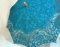 Battenburg Lace Parasol in Turquoise Blue. Can be found at www.parasolheaven.com