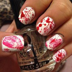 white and red blood splatter nails