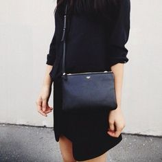 black monochromatic outfit | black skirt | black three quarter length sleeve top | slim black purse | casual minimal chic