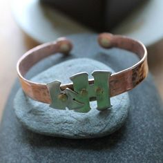 Hammered copper cuff bracelet with sterling initials secured by hand wrought brass rivets.