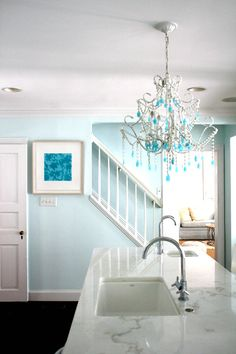 Paint color: Benjamin Moore Blue Bonnet with coordinating chandelier and artwork