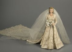 To commemorate Elizabeth's 1947 wedding to Philip Mountbatten, Duke of Edinburgh, doll artist Dorothy Heizer fashioned an amazing 15-inch figure of Elizabeth in her wedding gown, decorated with 45,000 hand-sewn pearls, rhinestones, and beads. Heizer painstakingly copied the design of the embroidered and beaded dress and train from photos of the original.