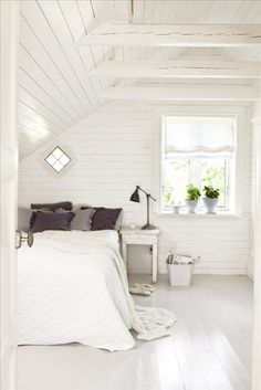 The parents' bedroom has white horizontal tongued and grooved board on the walls.  The floor is painted blue-gray.  Bed linen and ...
