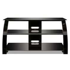 With contemporary flair, this TV Stand from Bell'O holds most flat screen TVs up to or 125 lb., and at least 4 audio video components on 3 tempered black glass shelves. The sturdy metal frame has a curved front for a dramatic look in any room. Tv Stand High Gloss, Tall Curtains, 55 Inch Tvs, Software, Home Entertainment Furniture, Hanging Room Dividers, Tv Accessories, Flatscreen, Flat Panel Tv