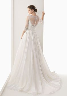 Classic A-line wedding dress with a wide, empire-waist flower belt, sweetheart neckline, lace illusion boat neck, three-quarter length sleeves, and high lace back with button-loop closure.