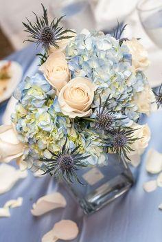 White roses and blue chrysanthemum wedding center pieces | Itan Images #weddingflowers #weddingdecor #receptioninspiration #weddinginspiration