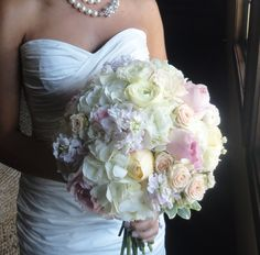 This season's bouquets are all about quiet, subdued creams and ivories with subtle hints of color--think blush, peach, goldenrod, lavender, grey. Large blooms of Peonies and Garden Roses mixed with delicate, ruffly Ranunculus, Hydrangea, Sweetheart Roses, and Stock provide the perfect round, full garden bouquet teeming with romance, beauty, and texture! Bouquet by @Event Floral.