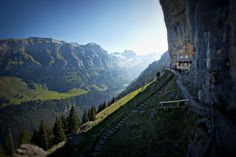 Photo of Berggasthaus Aescher, a mountain hut in the Ebenalp Summit in Switzerland with a scenic view of the Swiss Alps