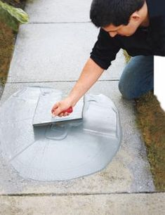 Trowel concrete resurfacer over your worn walkway, and you'll have a brand new, durable surface with uniform color. Before you get started, check out this how-to video on working with concrete: