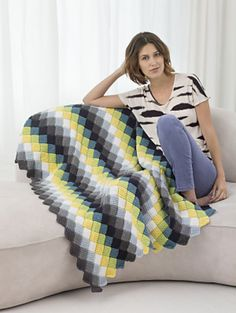 Teens will love the bold colorful stripes used to make this afghan. (Lion Brand Yarn)