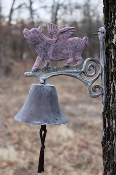 omigoodness! NEED! Distressed Cast Iron Flying PIG dinner bell...handpainted - distressed. $28.95, via Etsy.