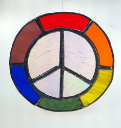 peace stained glass - -crinkled iridescent glass surrounded by a myriad of texture and color