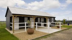 Three stables and feed room designed and built by The Stable Company.