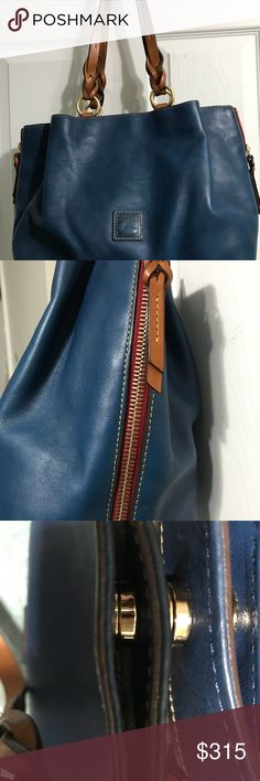 "Dooney and Bourke Florentine Large Zip Barlow bag Gorgeous Florentine large zip Barlow handbag from Dooney & Bourke in the color denim blue used a couple of times in very good condition minor marks from use on bottom and faint stains on corners.  It still has that Florentine leather smell. Spacious many pockets to keep you organized. This is from a smoke free home.  H 10"" x W 5.5"" x L 13"" Two outside snap pockets. Middle snap closure.One inside zip pocket. Two inside pockets. Inside key…"