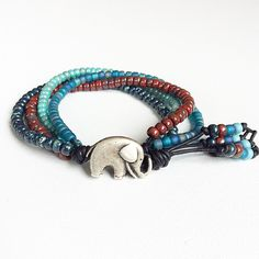 Beach boho style bracelet, beaded bracelet, multi coloured bracelet, beaded wrap bracelet handmade by rubybluejewels by Rubybluejewels on Etsy https://www.etsy.com/listing/493391730/beach-boho-style-bracelet-beaded