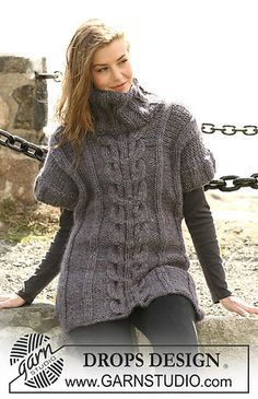 Short sleeved sweater with roll neck and cable design. Free pattern.